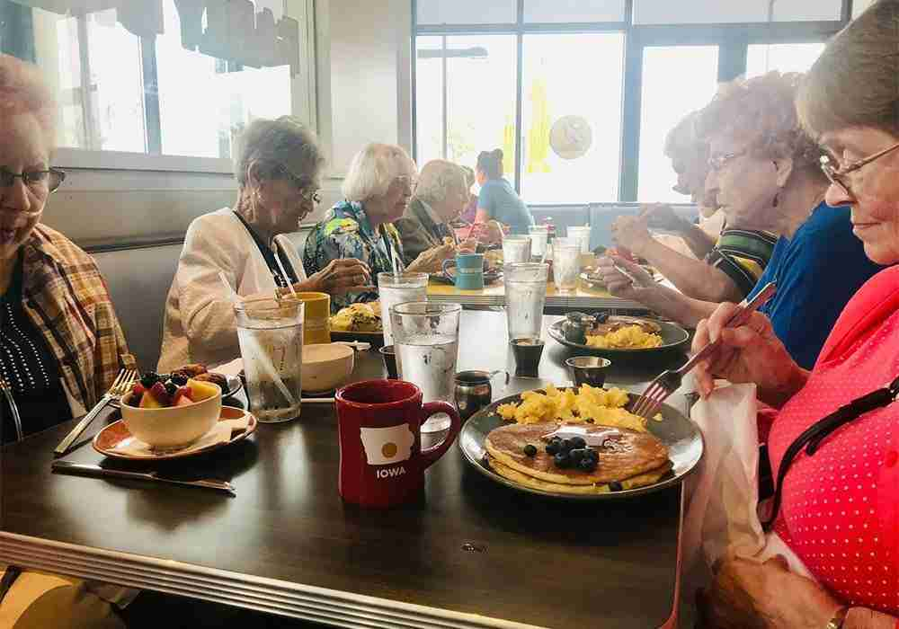 women eating breakfast at diner