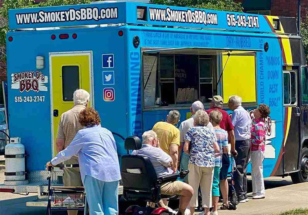 residents lined up outside of food truck