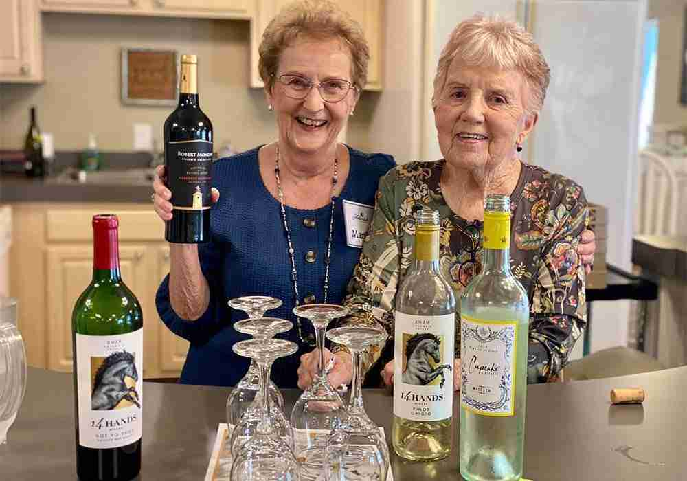 two ladies with wine